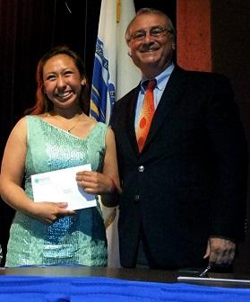 student receiving scholarship at Awards Night